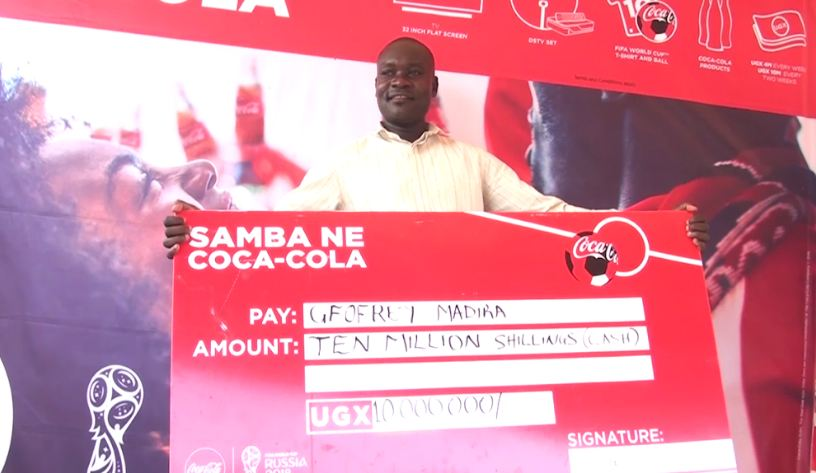 Geofrey Madira, an Arua-based hawker is a lucky winner of Ugx 10 million in the ongoing 'Samba Ne Coca-Cola' promotion.