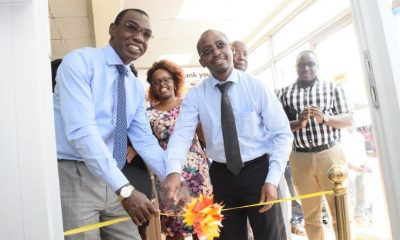 Vivo Energy Managing Director Mr. Gilbert Assi (L) and Goodlife Pharmacy's CFO Mr. Chris Kieu (R) officially launch the Goodlife pharmacy at Shell Namirembe in the Company of Vivo and Goodlife pharmacy staff.