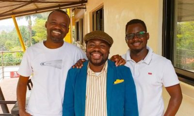 BOSCO poses with Eric Mununuzi (left) and Francis Xavier Kirabira at TBWA Uganda.