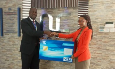 Jenna Kirabo is the first customer to receive the Visa debit card.