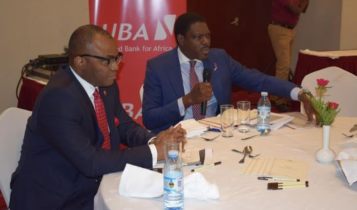 Emeke E. Iweriebor, the Executive Director /CEO East and Southern Africa and Johnson Agoreyo, the Managing Director and CEO of UBA Uganda during the media briefing.
