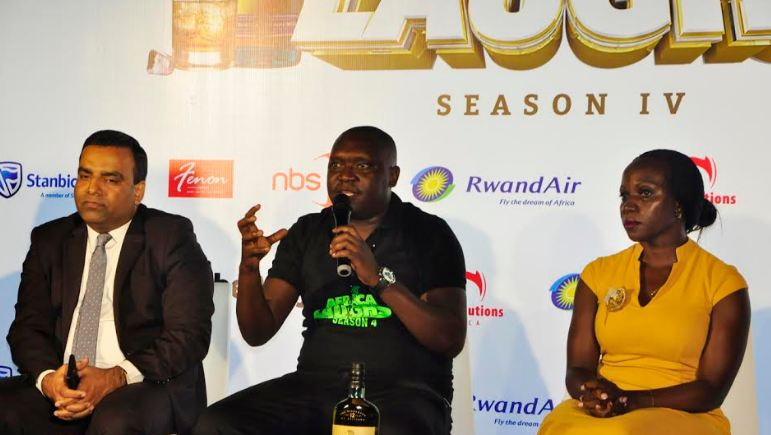 L-R: Speke Apartment's Assistant General Manager Sajeev Kulangarath,comedian Patrick Salvado Idringi, and UBL's Whisky Portfolio Manager Annette Nakiyaga,at the press conference to announce the Africa Laughs show.