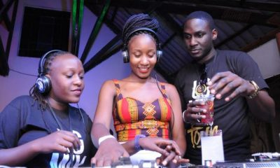 DJ MaryJo and DJ Ripper giving a reveller a tutorial on deejaying.