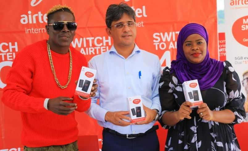 "Musician King Saha, Airtel CCO Amit Kapur and Airtel's Joweria Nabakka officially launch the ""My First 4G"" smartphone series."