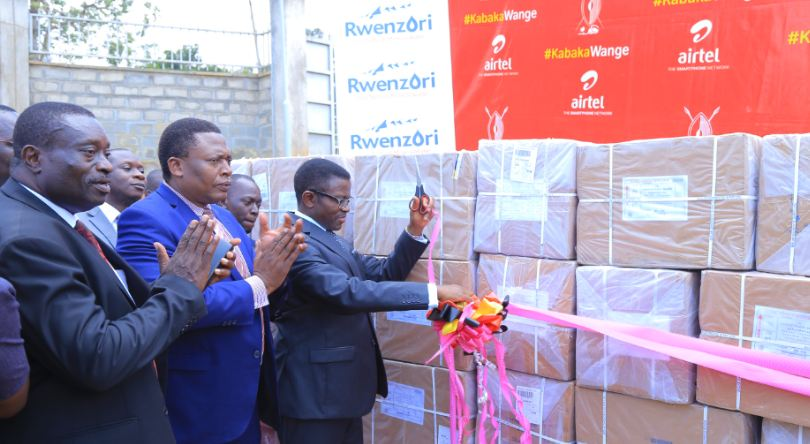 The Katikkiro Owek, Charles Peter Mayigga unveils the screening kits that were handed over to Central Public Health Laboratories on Tuesday.