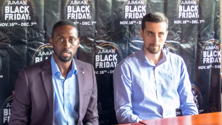 Ron Kawamara(L), the new ceo for Jumia Uganda addresses media. Looking on is Massimiliano Spalazzi, Jumia's co-CEO.