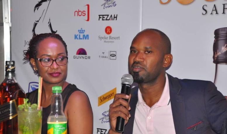 Roger Agamba, the International Premium Spirits Manager UBL addresses media. Looking on is the Stanbic's Sonia Kasagga.