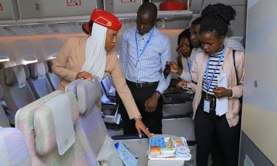 Emirates cabin crew member showing members of the media some of Emirate's various amenity kits during the static tour.