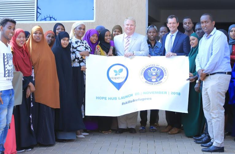 A team from the US Embassy poses for a group photo with some of the students at Hope Hub during the launch ceremony on Wednesday.