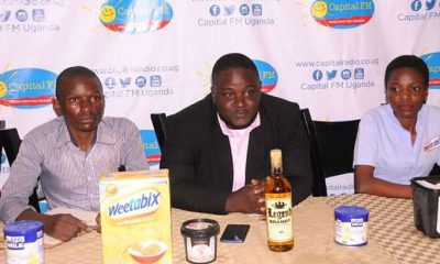 Norman Kasule (C), the marketing manager Ice Cream and Cake festival addressing media.