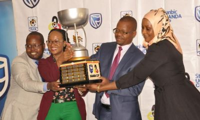 Sonia Karamagi, Stanbic Bank's Senior Marketing Manager (2nd Left), FUFA President Eng. Moses Magogo (2nd Right), Rogers Mulindwa, FUFA Head of Marketing and Communications (1st Left) and Nalule Aisha, FUFA Head of Competitions (1st Right) announce the 2018-2019 Stanbic Uganda Cup tournament at a press briefing held at Kampala Serena Hotel.