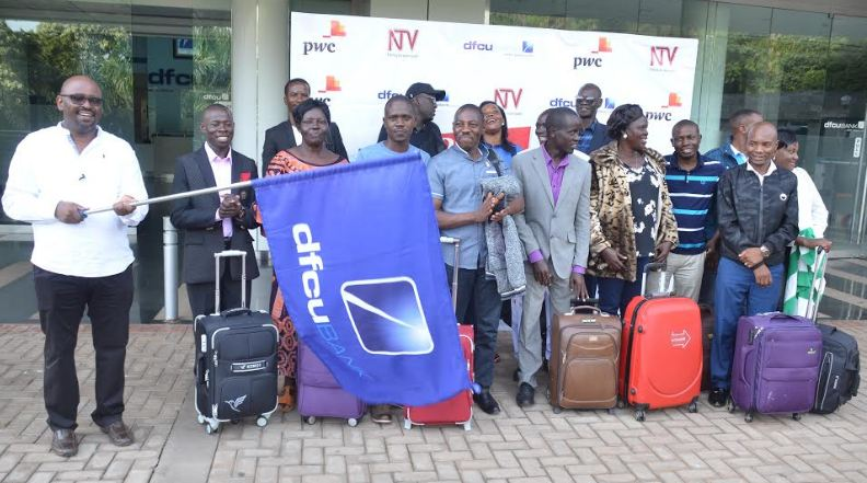dfcu Bank's Denis Kibukamusoke flags off representatives of the investment clubs who are headed for study trip in Nairobi.