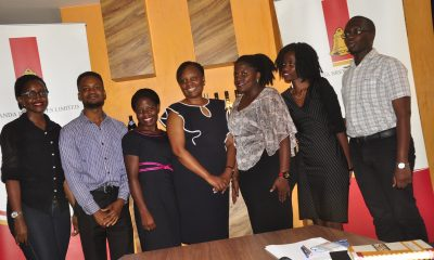 Uganda Breweries Human Resources Director Catherine Khabure(Centre) with the 2019 UBL graduate trainees Dorah Kukunda, Collin Kajubi , Patience Katulinde Brenda Kobutungi, Fridah Nakibuuka and Simon Patrick Lapyem.