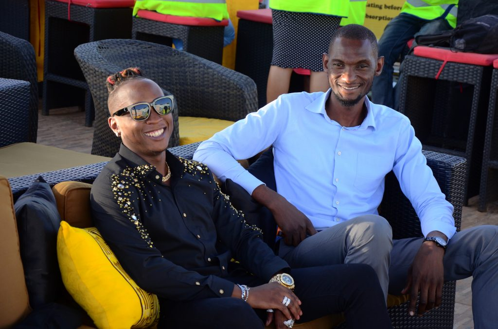 Beenie Gunter poses with Bell Lager Brand Manager Francis Kirabira.