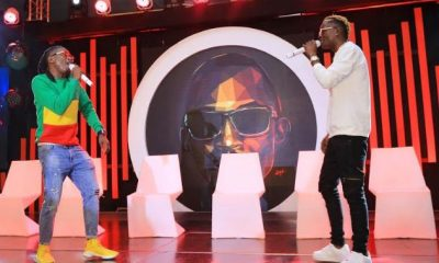 Weasel and King Saha pay tribute to late Mowzey Radio during the Coke Studio Africa launch held at the Golf Course Hotel.