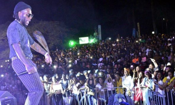 Burna Boy performs at the Kampala Sheraton Hotel gardens.