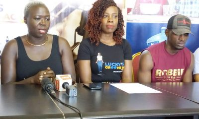 "Lucky Mbabazi (C) addresses media during the launch of her ""Lucky's Groove Back"" initiative. Looking on is Zumba queen Gerry Opoka(L) and Robert Ddamulira, a fitness instructor at Robbie Fitness."