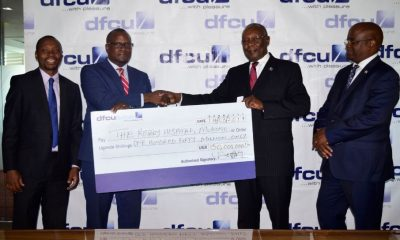 Mathias Katamba, CEO dfcu Bank hands over the cheque to Mr. Lwanga K Stephen, Rotary Club of Kampala President 2016/17 while on the right Mr.Ntegeka Andrew, Chairman Rotary Hospital Board looks on.