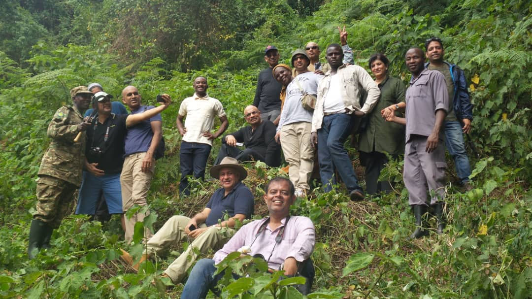 The delegation from India and local tour guides pose for a photo during Gorilla tracking in Bwindi