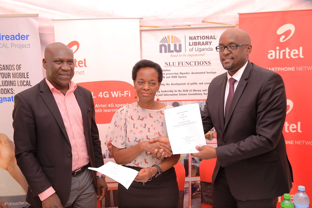 The Kampala Central Mayor Mr. Charles Musoke Sserunjogi, National Library of Uganda official Stella Nekuusa and Airtel Legal Director Mr. Dennis Kakonge present the signed contracts at the event to launch free 4G Airtel internet.