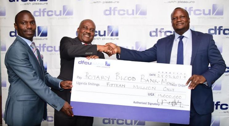 dfcu CEO Mathias Katamba hands over cheque for Rotary Blood Bank Mengo.