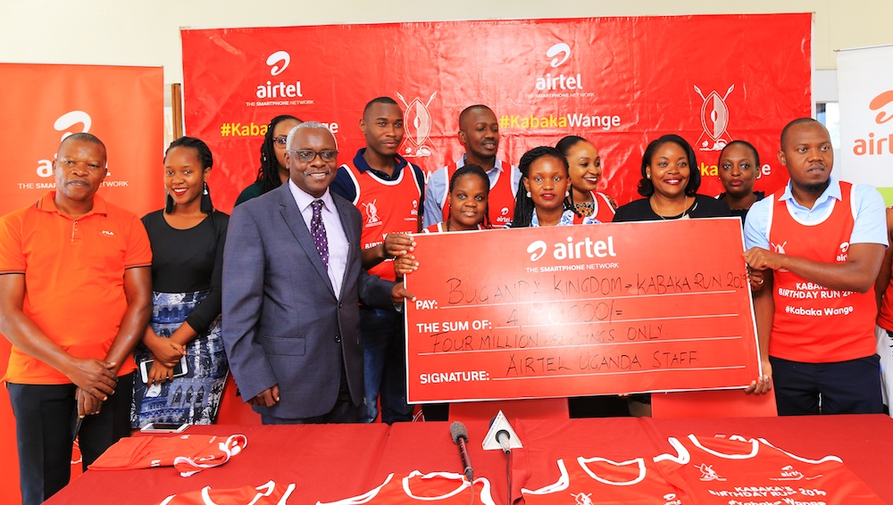 Airtel staff members hand over their contribution towards the Kabaka Run.