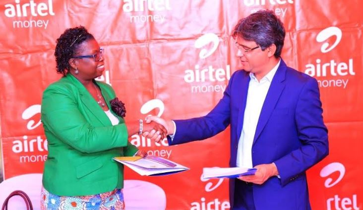 URA Commissioner General Doris Akol shakes hands with Airtel CCO Amit Kapur to seal the partnership.