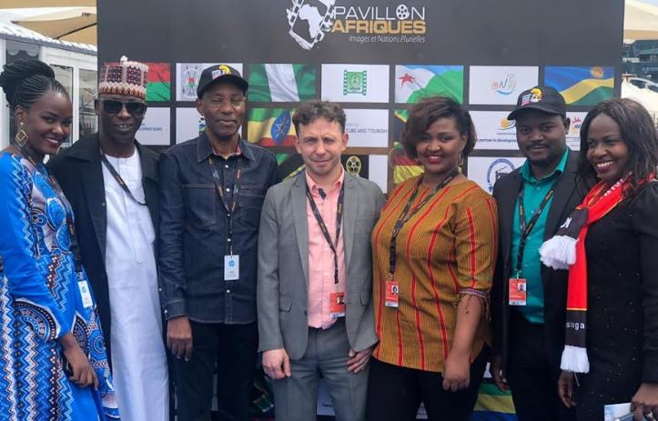 Uganda team at Cannes poses for a group photo after a panel discussion on Uganda's film industry at the African Pavilion in Cannes, France.