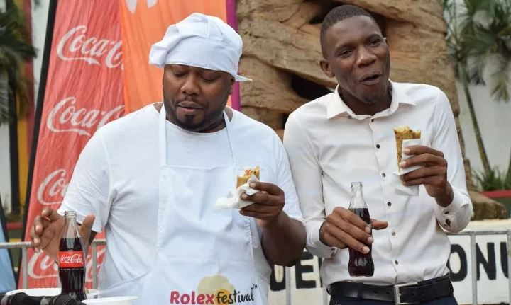 DJ Nimrod and comedian Daniel Kalela enjoy a rolex during the launch of the 2019 Rolex Festival.