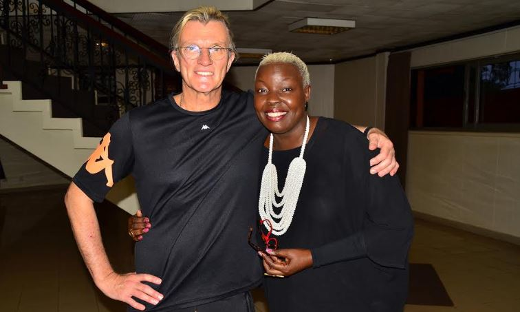 Jan Malan poses for a photo with Santa Anzo, the brains behind the Uganda International Fashion Show.