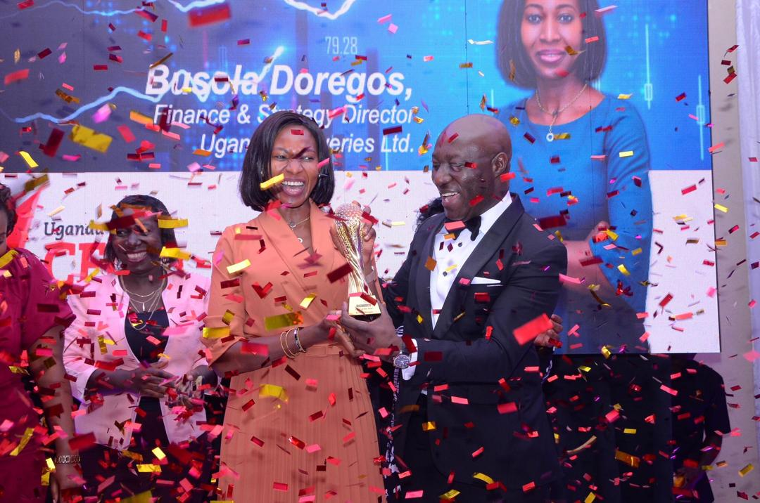 Uganda Breweries Finance & Strategy Director Busola Doregos receives the 2019 CFO of the year award from Joe Eshun, CEO Deloitte East Africa