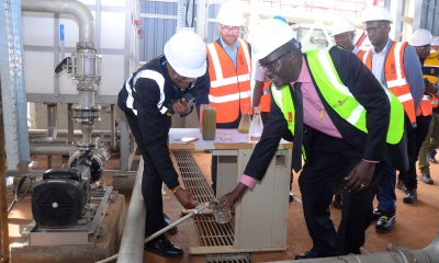 L-R: Uganda Breweries Supply Chain Director Anthony Njenga(L) and The Permanent Secretary Ministry of Water and Environment Alfred Okot Okidi (R) during the commissioning of the water recovery plant at UBL. Looking on is the EABL Group Managing Director Andrew Cowan and UBL Managing Director Alvin Mbugua (Extreme Right)