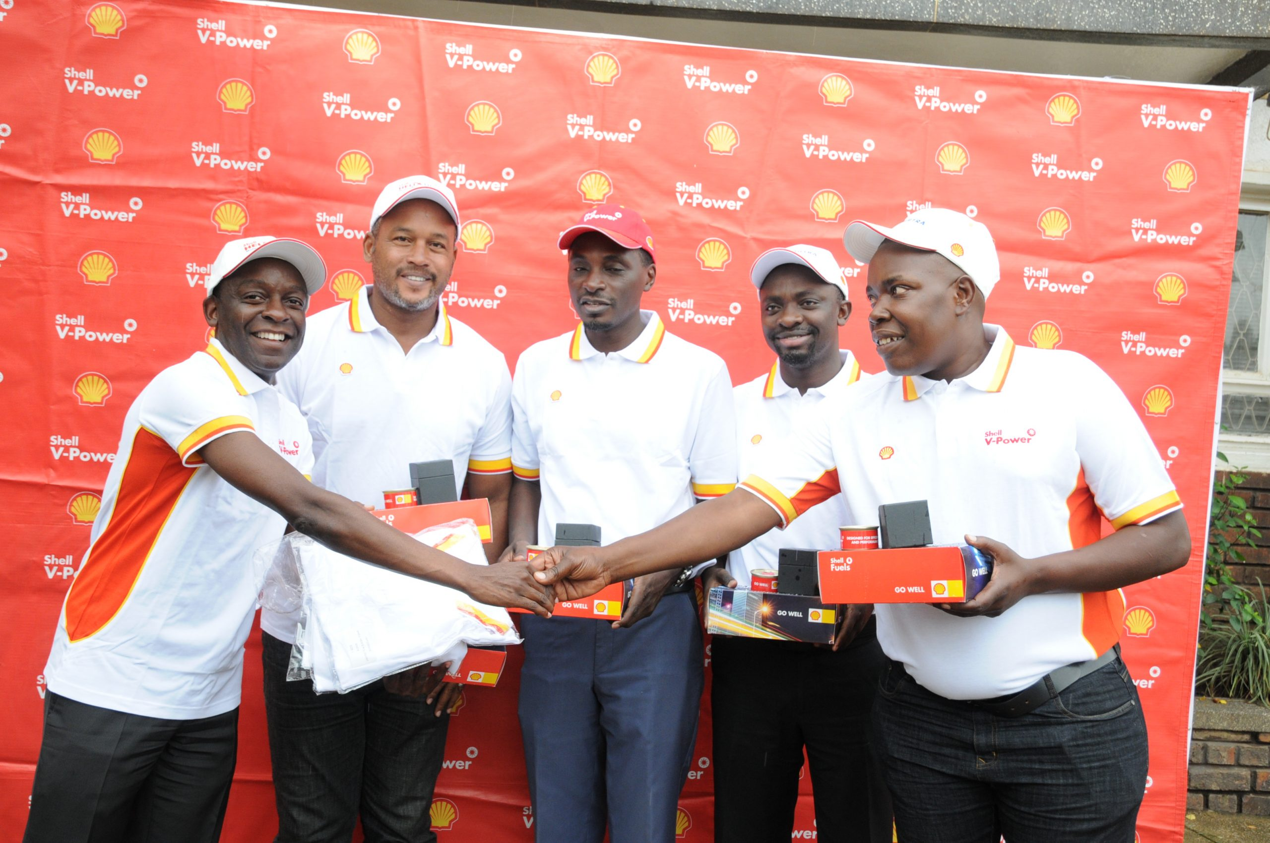Vivo Energy Marketing Manager Moses Kebba hands over fuel vouchers and goodies to Shell rally drivers Arthur Blick, Omar Mayanja, Umar Kakyama and Ronald Sebuguzi.
