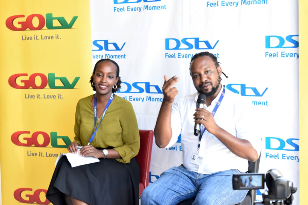 Joan Semanda Kizza(L), the Public Relations and Communications Manager at   MultiChoice Uganda and Colin Asiimwe, the Head of Marketing at MultiChoice Uganda addressing members of the press during the public launch of the Back to School campaign