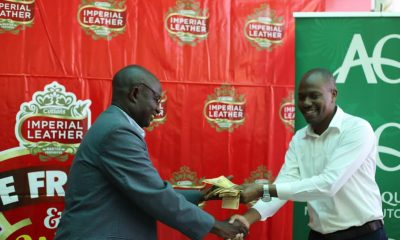 "Mr. Aggrey Masamba, (L) receives Ushs. 3 million cash prize from Mr. William Kakuru, Capital Shoppers Ntinda, Branch Manager, (R) during the Imperial Leather, ""Be Fresh and Win"" promotion."