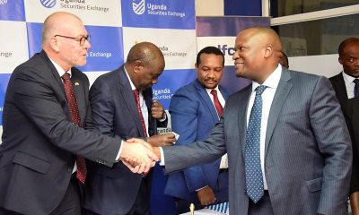 The Danish Embassy representative shakes hands with dfcu Bank Chief Executive Officer Mathias Katamba.