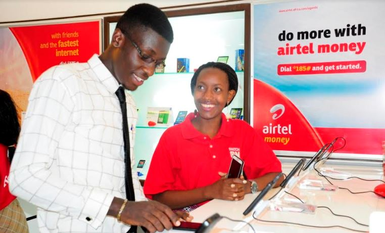 An Airtel Uganda customer care advisor attends to a customer at the company's Premium shop at Forrest Mall