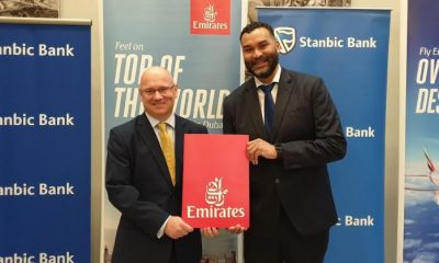 John Gemin (R), the Country Manager for Emirates in Uganda and Kevin Wingfield, the Executive Director Stanbic Bank Uganda officially unveil a promotion that will see the bank's Platinum Visa and Gold Credit Card holders receive special discounts on air tickets.