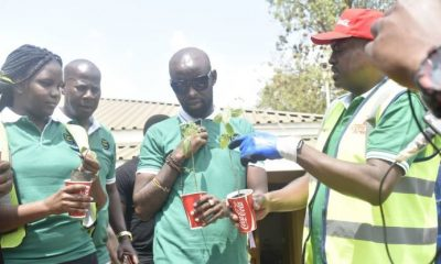 CCBA's Simon Kaheru (R), Musician Eddy Kenzo and representatives from ESSI share a moment a the launch of the tree planting campaign held on Friday at the Coca Cola plant in Namanve.