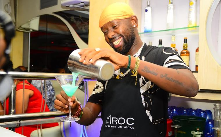 Eddy Kenzo making his signature cocktail during the Ciroc Pop Night.