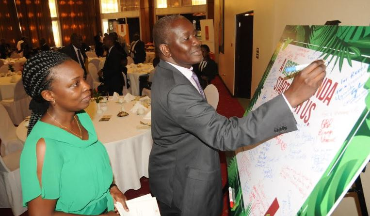 "The Permanent Secretary Ministry of Water and Environment Alfred Okot Okidi and Uganda Breweries Legal and Corporate relations director Charity Ekudu Kiyemba during the launch of the ""Running out of trees"" campaign in October last year."