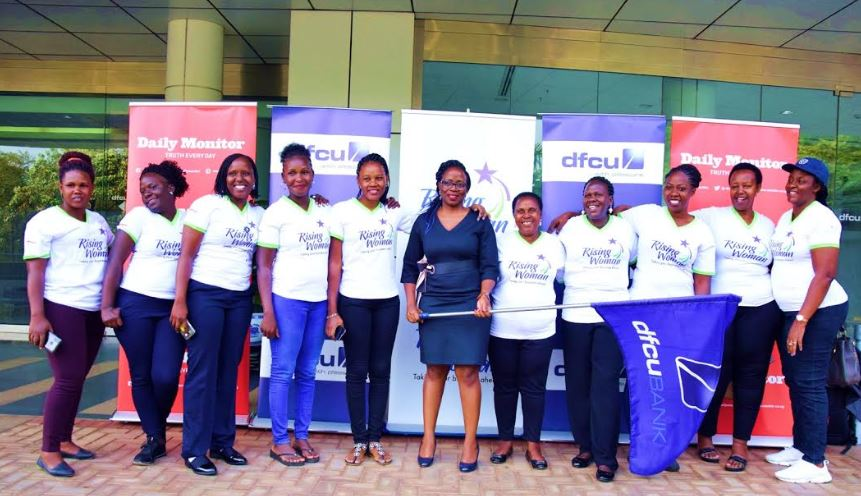 Belinda Namutebi, Council Member of dfcu Bank's Women Advisory Council flags off the women winners.