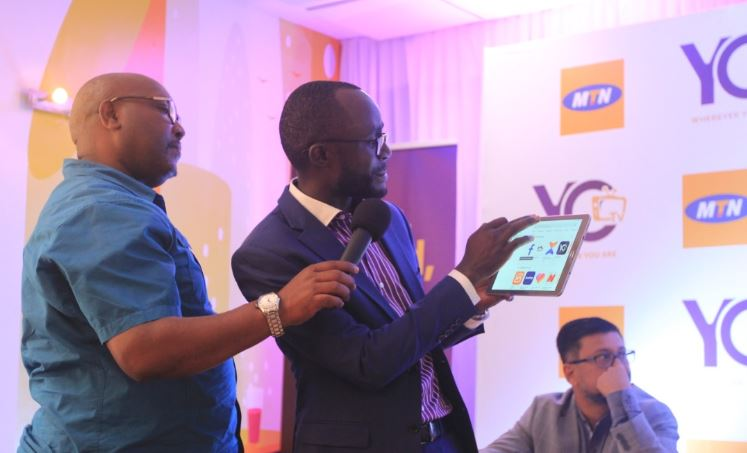 Aggrey Mugisha, the YoTV Channels CEO. demonstrates how the app works.