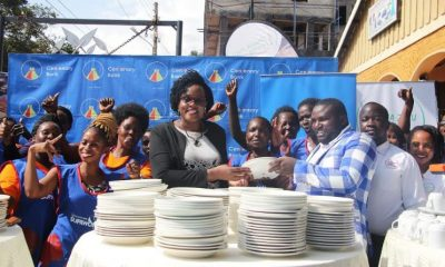 Mrs. Beatrice Lugalambi, the General Manager Corporate Communications & Marketing at Centenary Bank and Mr. Kikungwe Umar, the Managing Director at Shaka Zulu Foods Limited present assorted kitchen equipment worth 20 million to the Cente SupaWoman groups.