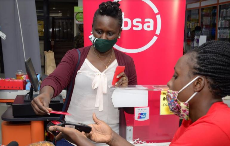 A customer pays for their shopping using a contactless Absa Visa Debit Card.