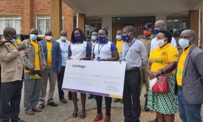 Bushenyi district CAO Mahabba Malik (with microphone) applauds the team from Letshego Uganda led by Joseph Kimbugwe (Head of MSE) during the UGX5M support to the Bushenyi Covid-19 Task Force handover in Bushenyi last weekend.