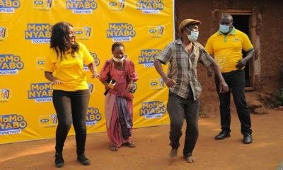 Betty Nanfuka and her husband jubilate after receiving their money won in MTN MoMo Nyabo promo.