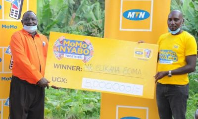 Elikana Ecima, the head teacher of Okollo Senior Secondary School won UGX 5 million in MoMo Nyabo promo.