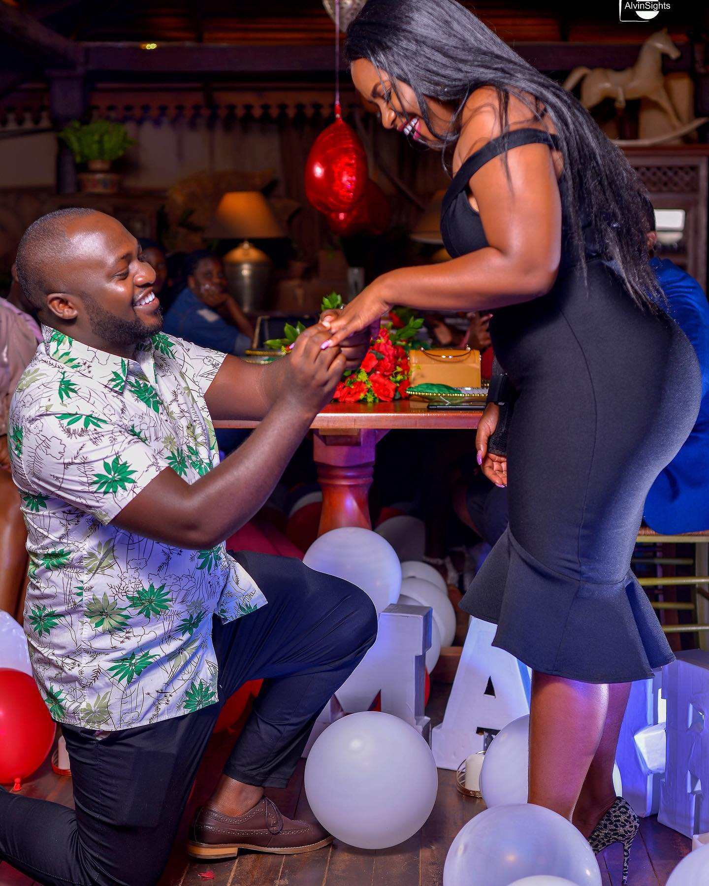 Beta on his knees as he proposes to girlfriend