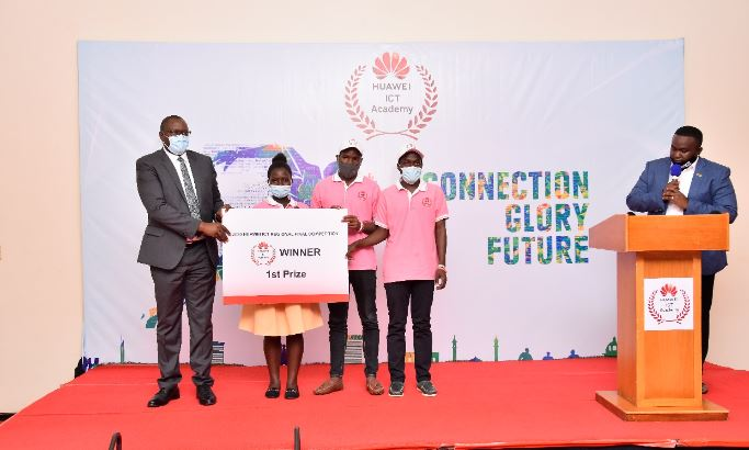 The Permanent Secretary of the Ministry of ICT and National Guidance Hon. Vicent Bagirre Waiswa with the winners Doreen Nalwoga, Shaffick Nyanzi and Emmanuel Kiguli